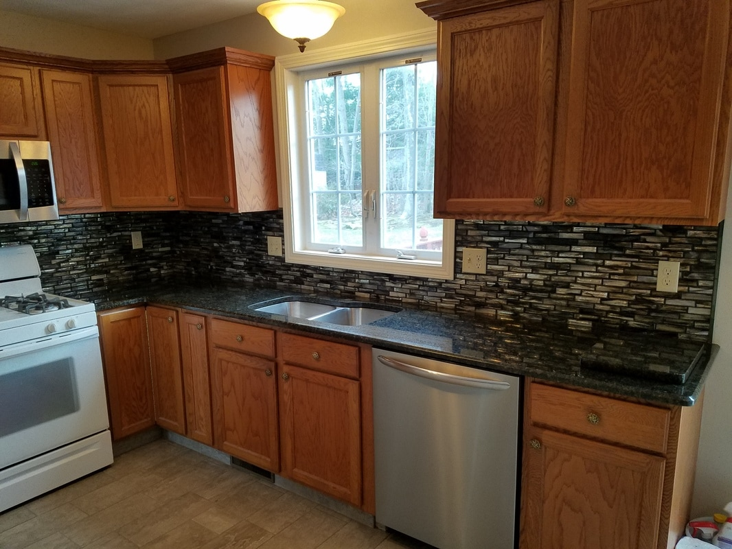 The Material Is An Entry Range Stone Called Ubatuba. The Contractor Paired  It With Some Beautiful Blue/gray Tile. Its A Simplistic But Elegant Style  And The ...